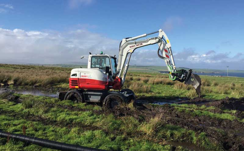 Digger in field