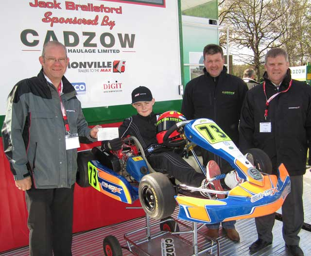 Young Jack is pictured on the Cadzow stand with his father Steven and Traffco's Peter and Mike Dougan.