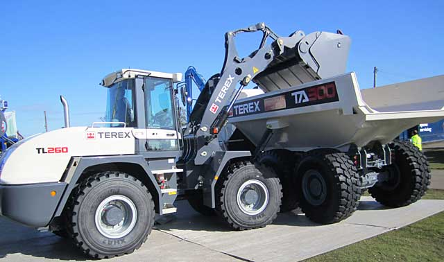 The TL260 shown in tandem with the TA300 articulated dump truck.